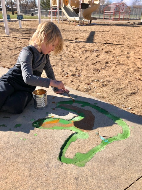Oliver painting dino track