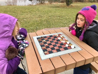 Outdoor checkers with rocks and shells