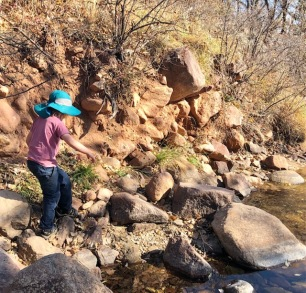 Scrambling boulders on the creek